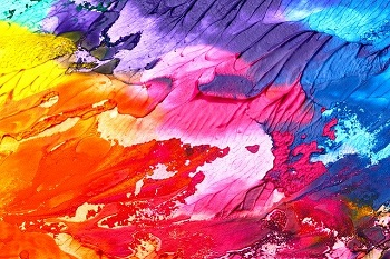 Oil paints in orange pink and purple up close, the texture would be felt as Accessible Art