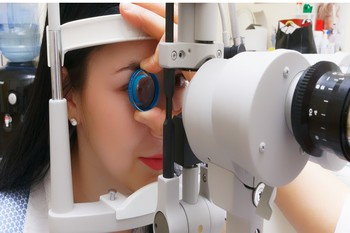 Picture Of Women Getting Eye Exam