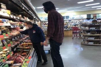 Visually Impaired Person In Grocery Store